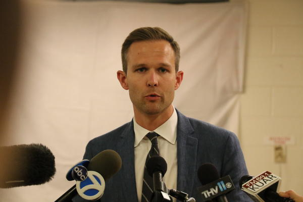 J.R. Davis, a spokesperson for Gov. Hutchinson, updates the media during Thursday night's proceedings