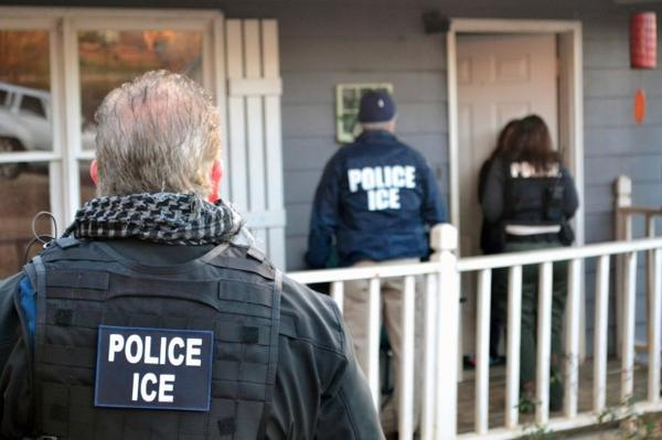 """<p></p><p class=""""p1""""><span class=""""s1"""">In this Feb. 9, 2017, photo provided U.S. Immigration and Customs Enforcement, ICE agents at a home in Atlanta, during a targeted enforcement operation aimed at immigration fugitives, re-entrants and at-large criminal aliens.</span></p>"""
