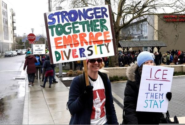 """<p></p><p class=""""p1""""><span class=""""s1"""">Protestors march with signs during a rally in Portland, Ore., Monday, Feb. 27, 2017. Immigrants and their supporters met outside the Immigration and Customs Enforcement building in downtown Portland to protest President Trump's immigration policies.</span></p>"""