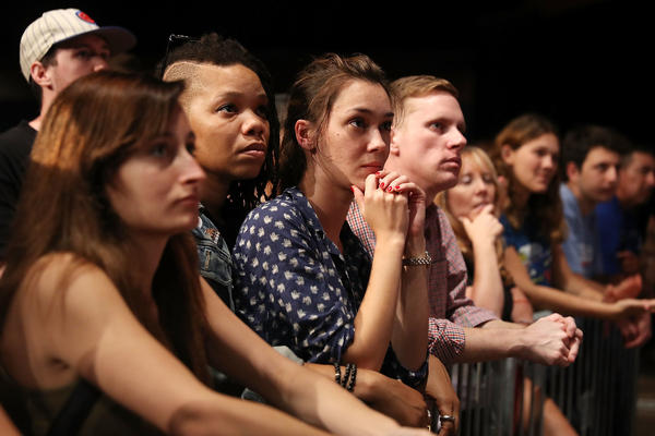 "People listen during an event that featured DNC Chair Tom Perez and Sen. Bernie Sanders during their ""Come Together and Fight Back"" tour at the James L Knight Center on Wednesday in Miami, Fla."