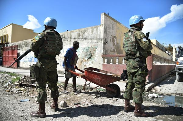 Brazilian members of the United Nations Stabilization Mission In Haiti stand by a shelter in Les Cayes ahead of a visit by U.N. Secretary-General Ban Ki-moon on October 15, 2016.