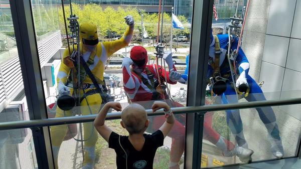 Window washers dressed as Power Rangers dangled outside Children's Hospital in Philadelphia this week. They thrilled the kids including one little girl who exchanged muscle poses with them.