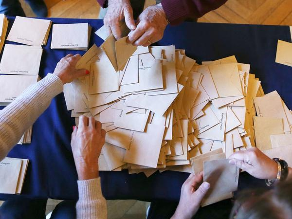 Ballots are prepared for counting at a polling station in Rouen, northern France, during the first round of the French presidential elections, on Sunday.