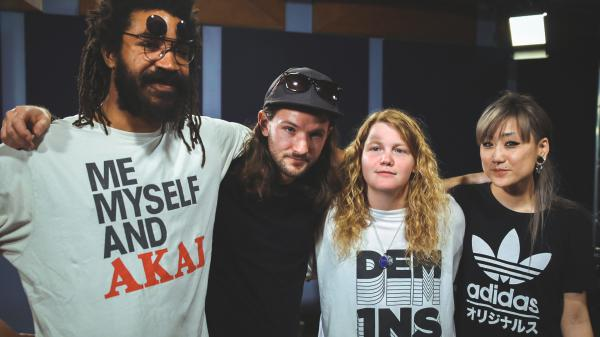 Kate Tempest (second from right), arm in arm with her band in the <em>World Cafe</em> performance studio.