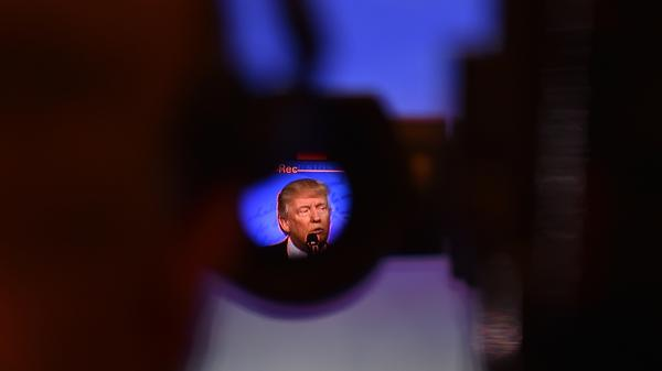 Through a video camera viewfinder, President Trump is seen addressing the crowd during the Conservative Political Action Conference in February.