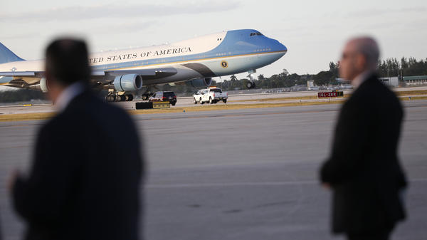 U.S. Secret Service agents stand on the tarmac as Air Force One lands in West Palm Beach, Fla., in February.