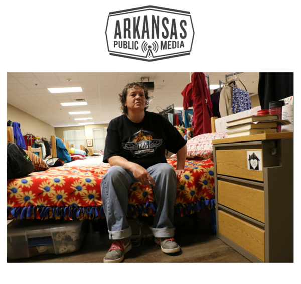 Echo Soza on her bed in a room she shares with over 40 women and children at Our House shelter in Little Rock