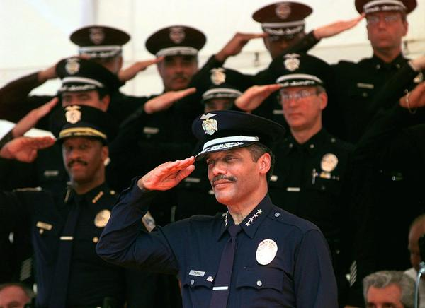 New LAPD Chief Bernard Parks returns the salute of his fellow officers during the change of command ceremonies at the Los Angeles police academy on Aug. 22, 1997.
