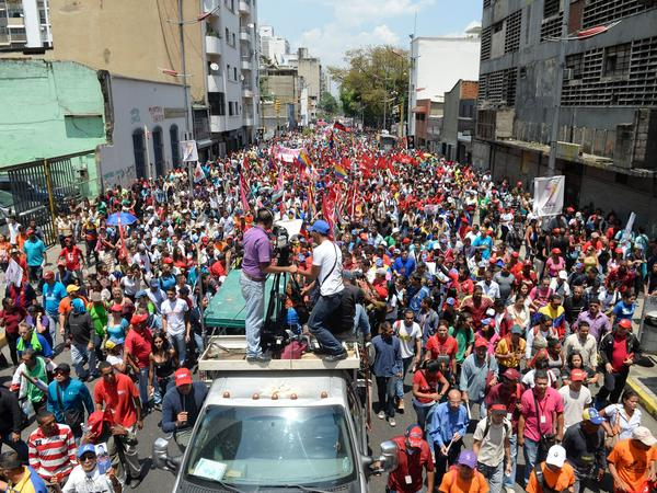 Supporters of Venezuelan President Nicolas Maduro march in the capital on Wednesday.