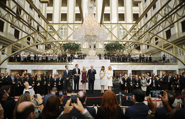 Then Republican presidential candidate Donald Trump (center) and his family prepare to cut the ribbon at the new Trump International Hotel on Oct. 26, 2016, in Washington, D.C.