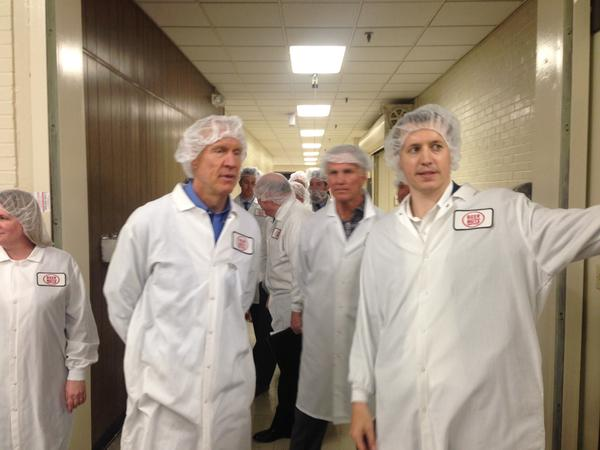 Governor Bruce Rauner tours the Beer Nuts factory in Bloomington accompanied by owner executives Jim and Andy Shirk