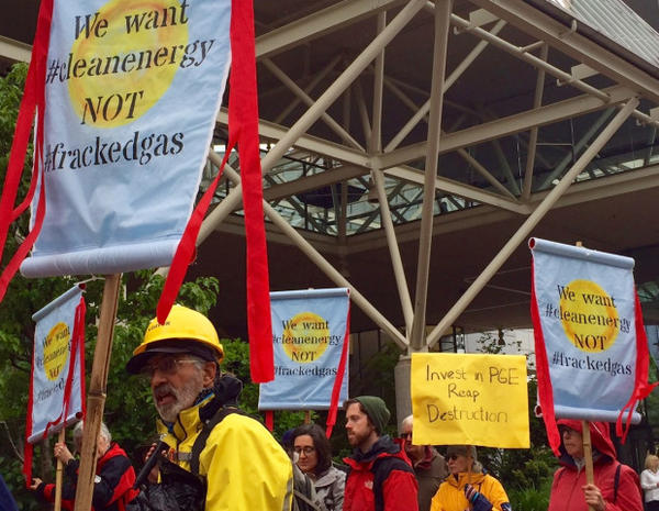 <p>Environmental groups gathered outside a Portland General Electric shareholders meeting Wednesday to protest the utility's plans to consider building two new natural gas power plants in Boardman.</p>