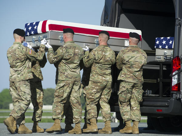 Soldiers transfer the remains of Army Sgt. Joshua Rodgers, 22, of Bloomington, Ill., at Dover Air Force Base, Del. Rodgers and Sgt. Cameron H. Thomas, 23, of Kettering, Ohio, were killed during a raid in Afghanistan.