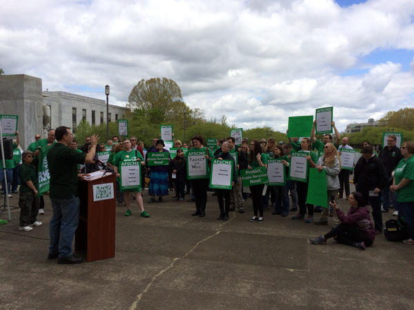 Members of AFSCME rally on the front steps of the Oregon Capitol Friday.