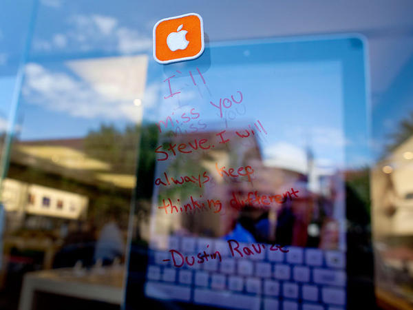 "<p>A note in tribute to Steve Jobs is seen on the window of an Apple Store, Thursday, Oct. 6, 2011, in Las Vegas: ""I'll miss you Steve. I will always keep thinking different.""</p>"