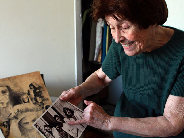 Elsa Sanchez de Oesterheld, 87, looks at pictures of her four daughters who were killed by the military dictatorship. Two of the daughters were pregnant when they were seized, but Oesterheld still does not know what happened to the babies.