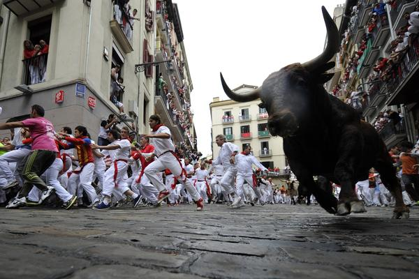 Running with the bulls down narrow cobblestone streets is a timeless tradition.
