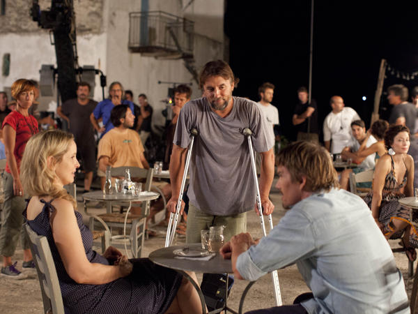 Richard Linklater (center) directs Julie Delpy and Ethan Hawke on the set of <em>Before Midnight</em>.