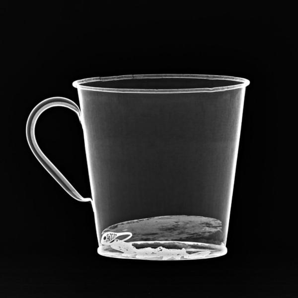 An X-ray reveals the jewelry concealed behind the false bottom, which separated from the mug after more than 70 years.