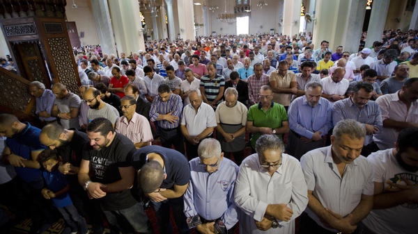 Egyptians pray for the victims of EgyptAir Flight 804 at Al-Thawrah Mosque in Cairo on Friday. The Egyptian military said it had found some wreckage of the plane, which was carrying 66 people when it went down early Thursday over the Mediterranean Sea.