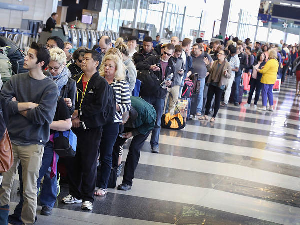 Passengers at O'Hare International Airport in Chicago wait to be screened at a Transportation Security Administration checkpoint on May 16.
