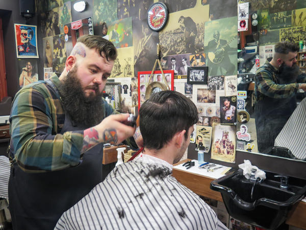 """Here in Moscow, it's still not very typical for people to wear head tattoos and piercing and beards,"" says barber Artemy Zolotarevsky. ""When people see me, some are amazed, some give me mean looks. And so I think I'm a bit of an outlaw."""