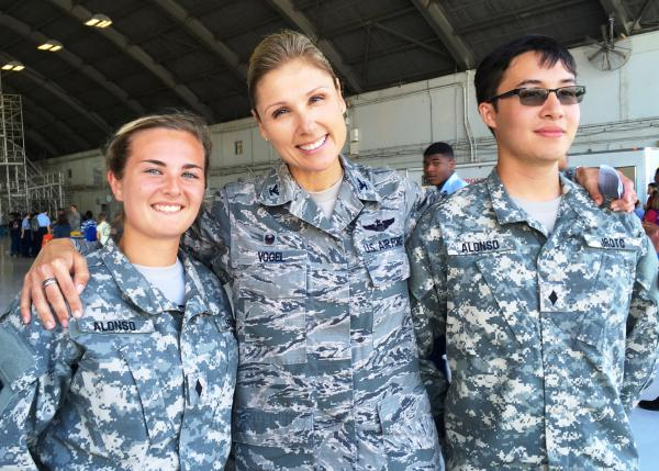 Center is MacDill AFB Commander Col. April Vogel posing with two cadets. Paula Hough and Don Lloyd, from Alonso High School Army JROTC during STEM Day.
