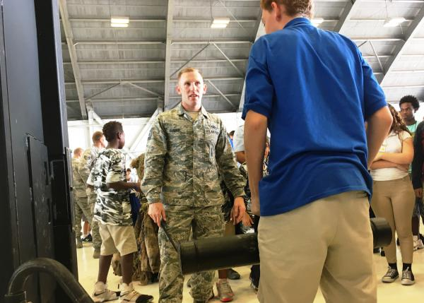 TSgt. Steven Barber offers tips on stance and aim to successfully break through the practice steel door.