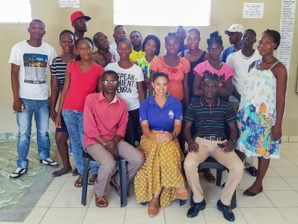 Stefani McCoy, seated in the center of the front row, was a high school dropout. After going back to school and completing her college degree, she joined the Peace Corps and went to Namibia to help fellow dropouts.