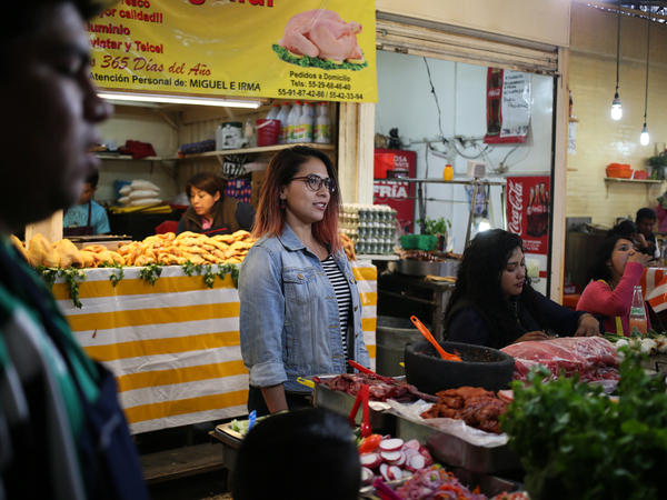 Anais Martinez, a guide with Eat Mexico, leads tours of the sprawling Merced market in Mexico City, where stalls sell tacos, sandwiches and pastries. A huge meal can cost less than $2.
