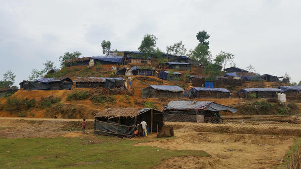 Small huts have been scraped out of the hillsides of the Balukali camp. Homes have blue plastic sheeting for walls, and roofs that are held together by thin strips of bamboo.