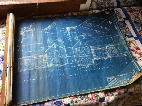 An original Sears blueprint and an instruction book told buyers how to put together their pre-cut, mail-order home step by step.