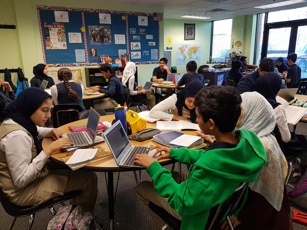 Eighth-graders write letters to local representatives about issues that concern them.