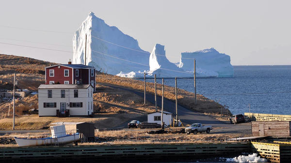 An iceberg looms large off the coast of Newfoundland on Sunday.