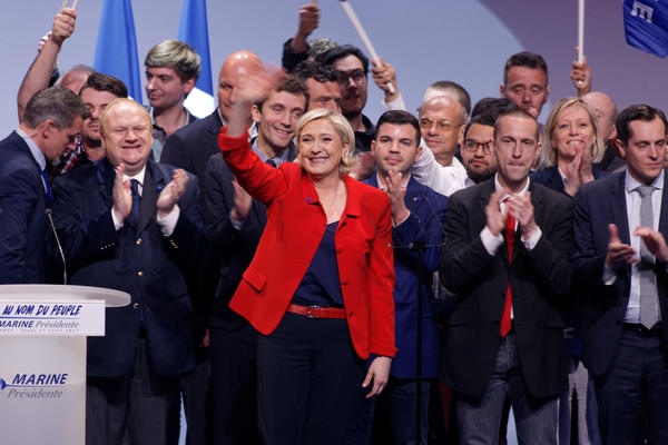 Marine Le Pen, presidential candidate of the far-right National Front, waves on stage during a campaign rally in Paris on April 17.