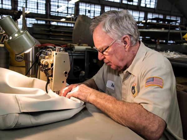 Richard Issacks was a B-52 pilot in Vietnam and then flew for American Airlines. Here, he works on a cushion.