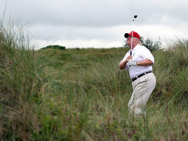Donald Trump plays a round of golf after the opening of The Trump International Golf Links Course on July 10, 2012, in Balmedie, Scotland.