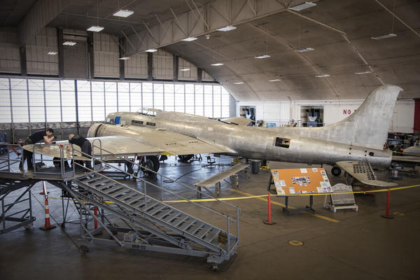 Technicians work to restore the B-17 bomber known as Memphis Belle at the National Museum of the United States Air Force near Dayton, Ohio.