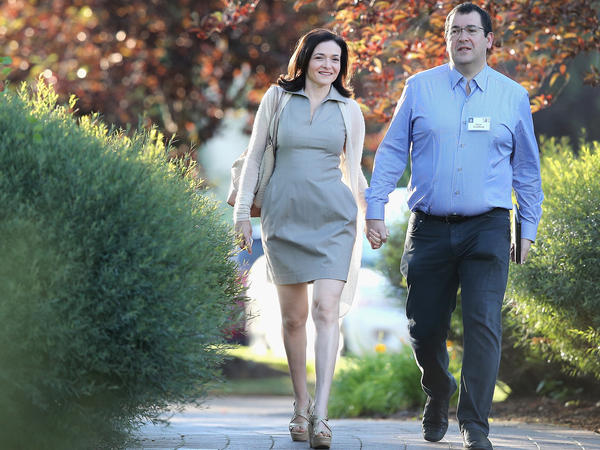 Sandberg and her husband Dave Goldberg, then-CEO of SurveyMonkey, attend a 2014 conference in Sun Valley, Idaho.