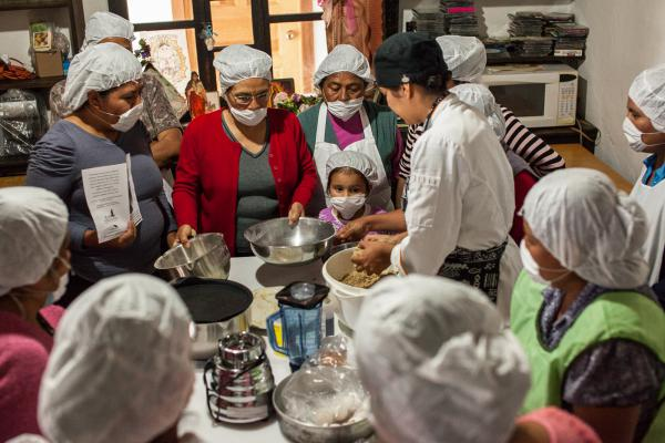 Gastronomy student Clarissa Moran (center) works with women in microenterprise groups to create new products with amaranth.