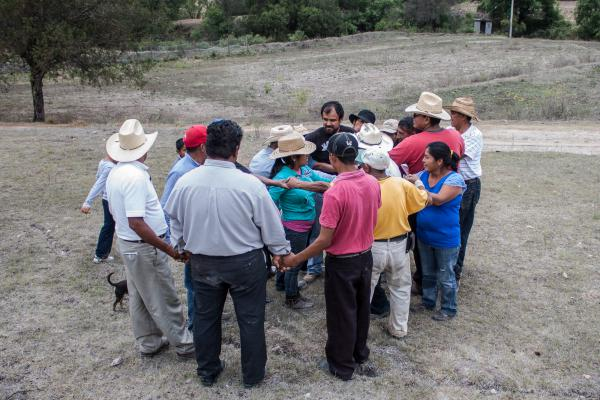 "Farmers participate in a trust-building exercise at an organic fertilizer workshop in the Mixteca region of Oaxaca, Mexico. Most of Puente's farmer partners practice what's known as agroecological farming — which prizes maintaining biodiversity — or are ""in transition"" to these methods."
