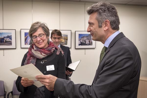 Linda Heuman, 53, receives her certificate of German citizenship from Ralf Horlemann,  the German consul general in Boston. (Robin Lubbock/WBUR)