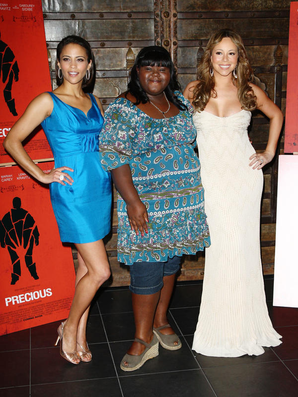 """Sidibe attends the 2009 Cannes Film Festival with <em>Precious</em> co-stars Paula Patton and Mariah Carey. She says, """"My whole outfit cost maybe $37."""""""