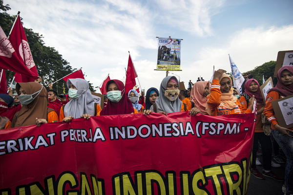 Indonesian demonstrators participate in a May Day protest in Surabaya. Millions of demonstrators took to the streets across the country to demand better social security, while rejecting outsourcing policies and low wages.