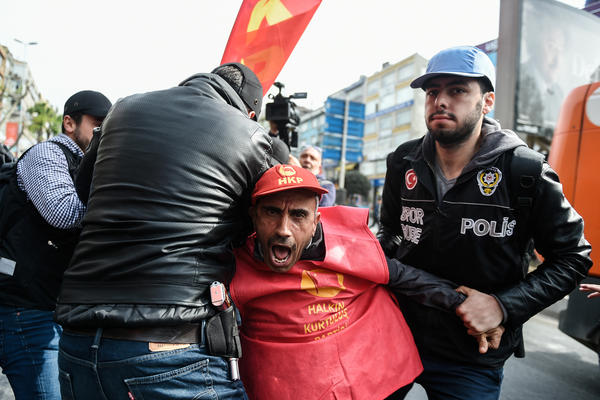 Turkish riot police clash with protesters as they attempt to defy a ban and march on Taksim Square to celebrate May Day in Istanbul.