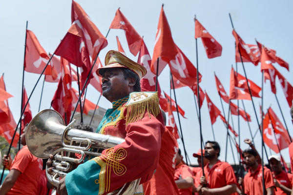 Workers and members of various trade unions dressed in red take part in a rally on the occasion of International Workers' Day in Bangalore, India.