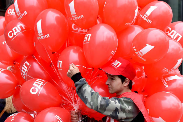 A young activist holds red balloons during a May Day rally organized by Ukrainian left-wing parties and trade unions in Kiev on Monday.