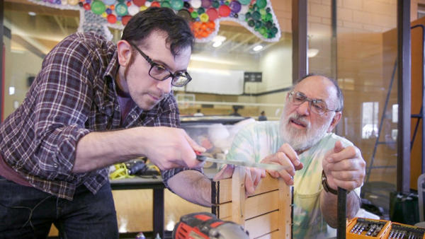 <p>Paul Savino (left) and his father Paul Savino Sr. volunteer at Repair Time, a fix-it clinic operated by Washington's King County.</p>