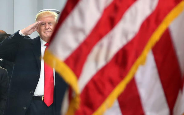 President Trump, seen saluting an American flag during his inaugural parade, issued a statement in honor of Loyalty Day on May 1, as many presidents have before him.