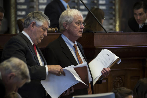 State Rep. Charlie Geren (right), who sponsored Senate Bill 4, listens to debate on the House floor Wednesday with state Rep. Paul Workman of Austin.
